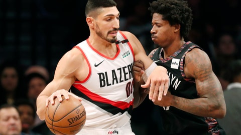 <p>               Portland Trail Blazers center Enes Kanter (00) works against Brooklyn Nets forward Ed Davis (17) during the first half of an NBA basketball game Thursday, Feb. 21, 2019, in New York. (AP Photo/Kathy Willens)             </p>