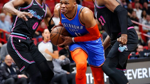 <p>               Oklahoma City Thunder guard Russell Westbrook, center, drives to the basket against Miami Heat guard Josh Richardson (0) and center Hassan Whiteside (21) during the first half of an NBA basketball game, Friday, Feb. 1, 2019, in Miami. (AP Photo/Wilfredo Lee)             </p>