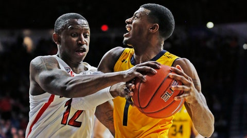 <p>               California guard Darius McNeill is defended by Arizona guard Justin Coleman (12) during the first half of pan NCAA college basketball game Thursday, Feb. 21, 2019, in Tucson, Ariz. (AP Photo/Rick Scuteri)             </p>