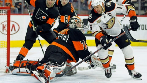 <p>               Philadelphia Flyers goalie Carter Hart sticks his leg out to block a scoring attempt by Anaheim Ducks' Ryan Getzal, right, during the first period of an NHL hockey game Saturday, Feb. 9, 2019, in Philadelphia. The Flyers won 6-2. (AP Photo/Tom Mihalek)             </p>