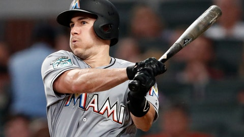 <p>               FILE - In this Tuesday, Aug. 14, 2018 file photo, Miami Marlins' J.T. Realmuto follows through on two-run base hit in the fourth inning of a baseball game against the Atlanta Braves in Atlanta. A person familiar with the negotiations says Miami Marlins All-Star catcher J.T. Realmuto has been traded to the Philadelphia Phillies for catcher Jorge Alfaro, two pitching prospects and international bonus pool allocation. The person confirmed the trade to The Associated Press on condition of anonymity Thursday, Feb. 7, 2019 because the teams had not announced it. (AP Photo/John Bazemore, File)             </p>