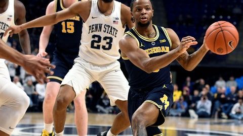 <p>               Michigan guard Zavier Simpson (3) passes the ball as Penn State guard Josh Reaves (23) defends during the first half of an NCAA college basketball game, Tuesday, Feb. 12, 2019, in State College, Pa. (AP Photo/John Beale)             </p>