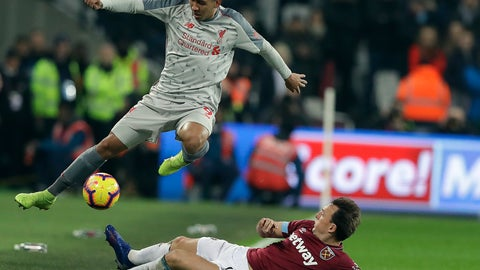 <p>               Liverpool's Roberto Firmino, left, and West Ham's Mark Noble challenge for the ball during the English Premier League soccer match between West Ham United and Liverpool at the London Stadium in London, Monday, Feb. 4, 2019.(AP Photo/Kirsty Wigglesworth)             </p>