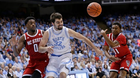 <p>               North Carolina's Luke Maye (32) loses the ball while driving to the basket against North Carolina State's DJ Funderburk (0) and Markell Johnson (11) during the first half of an NCAA college basketball game in Chapel Hill, N.C., Tuesday, Feb. 5, 2019. (AP Photo/Gerry Broome)             </p>