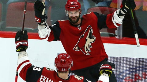<p>               Arizona Coyotes center Brad Richardson (15) smiles as he celebrates his hat trick against the Vancouver Canucks with defenseman Oliver Ekman-Larsson (23) during the second period of an NHL hockey game Thursday, Feb. 28, 2019, in Glendale, Ariz. (AP Photo/Ross D. Franklin)             </p>