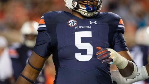 <p>               FILE - In this Sept. 29, 2018, file photo, Auburn defensive lineman Derrick Brown (5) warms up after a lightning delay in the first half of an NCAA college football game between Southern Miss and Auburn, in Auburn, Ala. (AP Photo/Vasha Hunt, File)             </p>