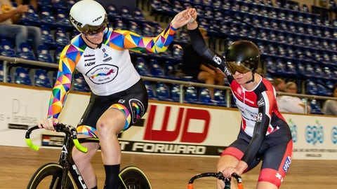 <p>               In this Oct. 13, 2018 photo provided by Craig Huffman, transgender cyclist Rachel McKinnon of Canada, left, holds hands with competitor Carolien Van Herrikhuyzen of the Netherlands during the UCI Masters Track Cycling World Championships in Carson, Calif. Initially, McKinnon was elated with her win, even though one of her top rivals pulled out of the final at the last minute. But there quickly was a downside to the victory, as a photo gained attention across the internet showing her on the podium with the two smaller, skinnier runners-up. (Craig Huffman/Craig Huffman Photography via AP)             </p>