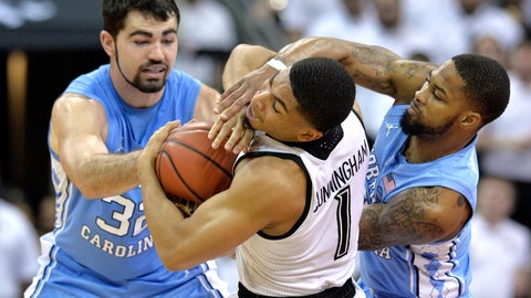 <p>               North Carolina forward Luke Maye (32) and guard Seventh Woods (0) battle Louisville guard Christen Cunningham (1) for the ball during the first half of an NCAA college basketball game in Louisville, Ky., Saturday, Feb. 2, 2019. (AP Photo/Timothy D. Easley)             </p>