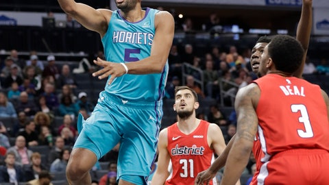 <p>               Charlotte Hornets forward Nicolas Batum (5) drives past Washington Wizards guard Bradley Beal (3) and Washington Wizards guard Tomas Satoransky (31) during the first half of an NBA basketball game in Charlotte, N.C., Friday, Feb. 22, 2019. (AP Photo/Chuck Burton)             </p>