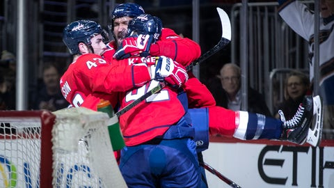 <p>               Washington Capitals center Evgeny Kuznetsov (92), of Russia, celebrates after scoring with right wing Tom Wilson (43) and left wing Alex Ovechkin (8), of Russia, during the second period of an NHL hockey game against the Los Angeles Kings, Monday, Feb. 11, 2019, in Washington. (AP Photo/Al Drago)             </p>
