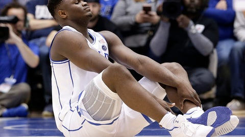 <p>               Duke's Zion Williamson sits on the floor following a injury during the first half of an NCAA college basketball game against North Carolina in Durham, N.C., Wednesday, Feb. 20, 2019. (AP Photo/Gerry Broome)             </p>