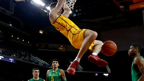<p>               Southern California's Nick Rakocevic, second from right, dunks against Oregon during the second half of an NCAA college basketball game Thursday, Feb. 21, 2019, in Los Angeles. (AP Photo/Ringo H.W. Chiu)             </p>