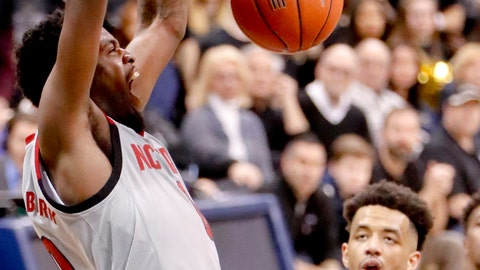 <p>               North Carolina State's DJ Funderburk, left, dunks as Pittsburgh's Terrell Brown (21) looks on during the second half of an NCAA college basketball game, Saturday, Feb. 9, 2019, in Pittsburgh. (AP Photo/Keith Srakocic)             </p>