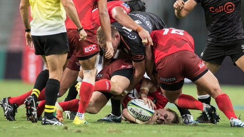 <p>               Hayden Parker of the Sunwolves gets tackled by Tyler Paul of the Sharks during the Super Rugby match between the Sunwolves and the Sharks at Singapore National Stadium, in Singapore, Saturday, Feb. 16, 2019. (AP Photo/Danial Hakim)             </p>