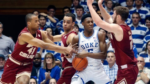 <p>               Duke's RJ Barrett (5) is defended by Boston College's Steffon Mitchell (41), Jordan Chatman and Nik Popovic (21) during the first half of an NCAA college basketball game in Durham, N.C., Tuesday, Feb. 5, 2019. (AP Photo/Chris Seward)             </p>
