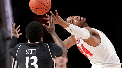 <p>               Cincinnati forward Trevon Scott (13) and Houston forward Breaon Brady (24) reach for a rebound during the first half of an NCAA college basketball game Sunday, Feb. 10, 2019, in Houston. (AP Photo/Michael Wyke)             </p>