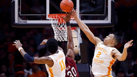 <p>               Tennessee forward Grant Williams (2) blocks the shot of South Carolina forward Chris Silva (30) as forward Kyle Alexander (11) defends during the first half of an NCAA college basketball game Wednesday, Feb. 13, 2019, in Knoxville, Tenn.  (AP photo/Wade Payne)             </p>