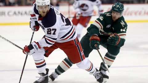 <p>               Winnipeg Jets' Nikolaj Ehlers (27) carries the puck in front of Minnesota Wild Eric Staal (12) during the second period of an NHL hockey game Tuesday, Feb. 26, 2019, in Winnipeg, Manitoba. (Trevor Hagan/The Canadian Press via AP)             </p>