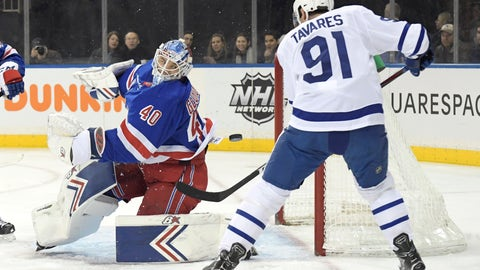 <p>               New York Rangers goaltender Alexandar Georgiev (40) eyes the puck as Toronto Maple Leafs center John Tavares (91) attempts to get his stick on the puck during the first period of an NHL hockey game Sunday, Feb. 10, 2019, at Madison Square Garden in New York. (AP Photo/ Bill Kostroun)             </p>