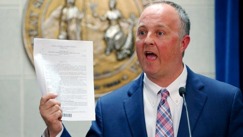 "<p>               FILE - In this March 28, 2017, file photo, North Carolina House Democratic leader Darren Jackson holds up a copy of HB 186, which was a compromise bill to replace HB 2, in Raleigh, N.C. The NBA All-Star Game is set for North Carolina this weekend after the league delayed Charlotte hosting the event for two years because of the state's ""bathroom bill."" (Chris Seward/The News & Observer via AP, File)             </p>"