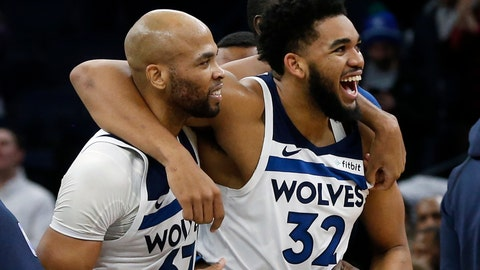 <p>               Minnesota Timberwolves' Karl-Anthony Towns, right, and Taj Gibson celebrate Towns' game-winning shot in overtime against the Memphis Grizzlies in an NBA basketball game Wednesday, Jan. 30, 2019, in Minneapolis. The Timberwolves won 99-97. (AP Photo/Jim Mone)             </p>