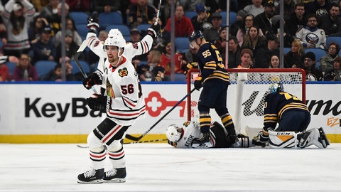 <p>               Chicago Blackhawks defenseman Erik Gustafsson (56) celebrates a Chicago goal during the second period of the team's NHL hockey game against the Buffalo Sabres in Buffalo, N.Y., Friday, Feb. 1, 2019. (AP Photo/Adrian Kraus)             </p>