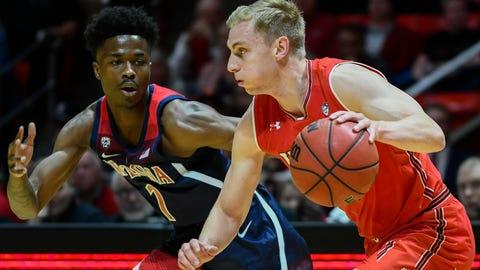 <p>               Arizona guard Devonaire Doutrive (1) defends Utah guard Parker Van Dyke, right, during the first half of an NCAA college basketball game Thursday, Feb. 14, 2019, in Salt Lake City. (AP Photo/Alex Goodlett)             </p>