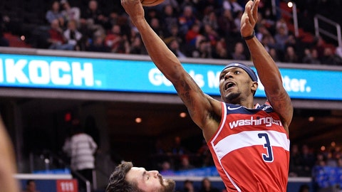 <p>               Washington Wizards guard Bradley Beal (3) goes to the basket against Cleveland Cavaliers forward Kevin Love (0) during the first half of an NBA basketball game Friday, Feb. 8, 2019, in Washington. Love was called for a foul on the play. (AP Photo/Nick Wass)             </p>