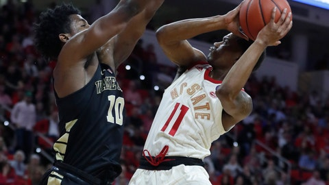 <p>               North Carolina State's Markell Johnson (11) shoots as Wake Forest's Jaylen Hoard (10) defends during the first half of an NCAA college basketball game, Sunday, Feb. 24, 2019 in Raleigh, N.C. (Ethan Hyman/The News & Observer via AP)             </p>