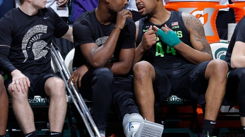 <p>               Michigan State's Nick Ward, right, talks with Joshua Langford, center, and Jack Hoiberg, left, while on the bench during the second half of an NCAA college basketball game against Ohio State, Sunday, Feb. 17, 2019, in East Lansing, Mich. (AP Photo/Al Goldis)             </p>