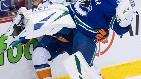 <p>               Vancouver Canucks goalie Jacob Markstrom, front, of Sweden, loses his balance as New York Islanders' Anders Lee skates into him during the second period of an NHL hockey game Saturday, Feb. 23, 2019, in Vancouver, British Columbia. (Darryl Dyck/The Canadian Press via AP)             </p>