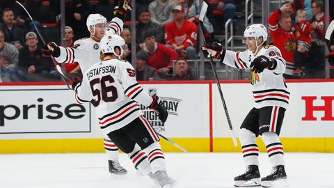 <p>               Chicago Blackhawks right wing Patrick Kane, right, celebrates his goal in overtime of an NHL hockey game against the Detroit Red Wings, Wednesday, Feb. 20, 2019, in Detroit. Chicago won 5-4. (AP Photo/Paul Sancya)             </p>