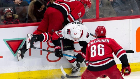 <p>               Carolina Hurricanes left wing Teuvo Teravainen (86) looks on as Ottawa Senators center Jean-Gabriel Pageau (44) collides with Hurricanes center Sebastian Aho (20) along the boards during the third period of an NHL hockey game, Tuesday, Feb. 12, 2019, in Ottawa, Ontario. (Adrian Wyld/The Canadian Press via AP)             </p>