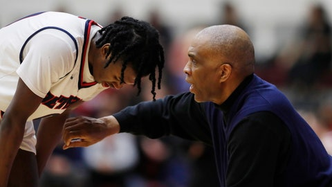 <p>               Detroit Mercy head coach Mike Davis talks to his guard Antoine Davis, his son, during the second half of an NCAA college basketball game against IUPUI, Thursday, Feb. 28, 2019, in Detroit. Davis tied and broke Steph Curry's NCAA record for 3-point baskets by a freshman. (AP Photo/Carlos Osorio)             </p>