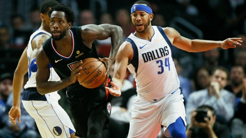 <p>               Los Angeles Clippers guard Patrick Beverley, center, splits the defense against Dallas Mavericks guard Devin Harris, right, and guard Trey Burke, left, during the first half of an NBA basketball game in Los Angeles, Monday, Feb. 25, 2019. (AP Photo/Alex Gallardo)             </p>