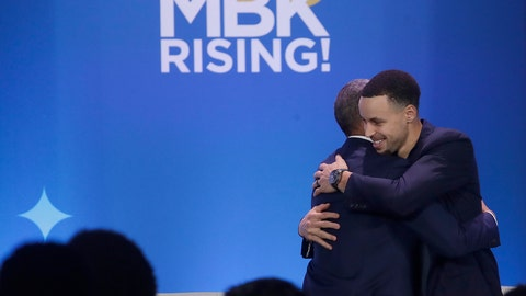 <p>               Former President Barack Obama, left, hugs Golden State Warriors basketball player Stephen Curry after speaking at the My Brother's Keeper Alliance Summit in Oakland, Calif., Tuesday, Feb. 19, 2019. (AP Photo/Jeff Chiu)             </p>