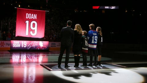 <p>               From left to right Shane Doan, left, wife Andrea Doan, children Carson Doan, Josh Doan, and Karys Doan, watch as the Arizona Coyotes retire Shane's jersey during a ceremony prior to an NHL hockey game against the Winnipeg Jets Sunday, Feb. 24, 2019, in Glendale, Ariz. (AP Photo/Ross D. Franklin)             </p>