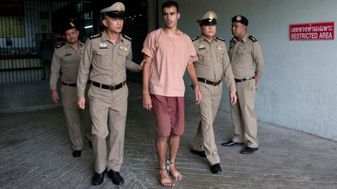 <p>               Bahraini Hakeem al-Araibi, center, leaves the criminal court in Bangkok, Thailand, Bangkok, Thailand, Monday, Feb. 4, 2019. The soccer player who has refugee status in Australia told a Thai court Monday that he refuses to be voluntarily extradited to Bahrain, which has asked for his return to serve a prison sentence for a crime he denies committing.(AP Photo/Sakchai Lalit)             </p>
