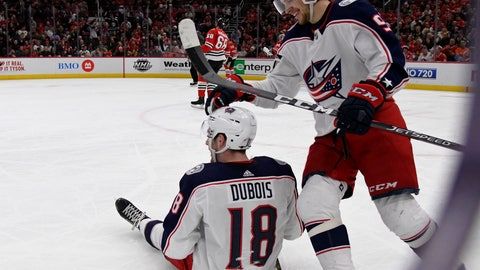 <p>               Columbus Blue Jackets center Pierre-Luc Dubois (18) gets a pat on the head from left wing Artemi Panarin (9) after he fell to the ice following a goal against the Chicago Blackhawks during the first period of an NHL hockey game Saturday, Feb. 16, 2019, in Chicago. (AP Photo/Matt Marton)             </p>