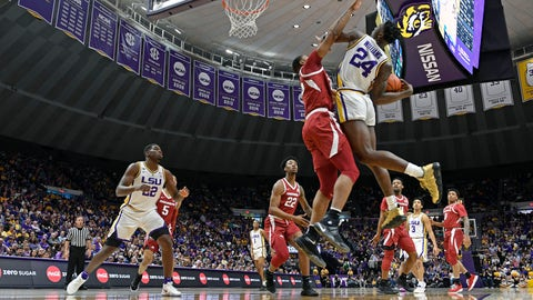 <p>               Arkansas forward Reggie Chaney defends against LSU forward Emmitt Williams (24) during the first half of an NCAA college basketball game Saturday, Feb. 2, 2019, in Baton Rouge, La. (AP Photo/Bill Feig)             </p>
