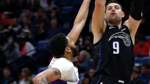 <p>               Orlando Magic center Nikola Vucevic (9) shoots over New Orleans Pelicans forward Anthony Davis (23) during the first half of an NBA basketball game in New Orleans, Tuesday, Feb. 12, 2019. (AP Photo/Tyler Kaufman)             </p>
