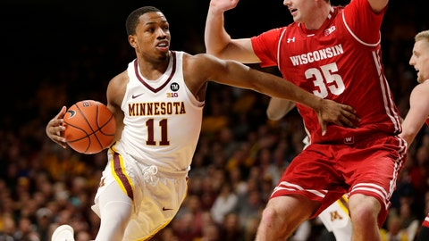 <p>               Minnesota guard Isaiah Washington (11) drives on Wisconsin forward Nate Reuvers (35) during the first half of an NCAA college basketball game Wednesday, Feb. 6, 2019, in Minneapolis. (AP Photo/Andy Clayton-King)             </p>