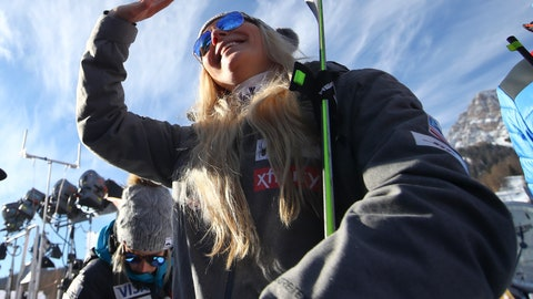 <p>               United States' Lindsey Vonn waves as she stands in the finish area after completing an alpine ski, women's World Cup super-G in Cortina D'Ampezzo, Italy, Sunday, Jan. 20, 2019. (AP Photo/Alessandro Trovati)             </p>
