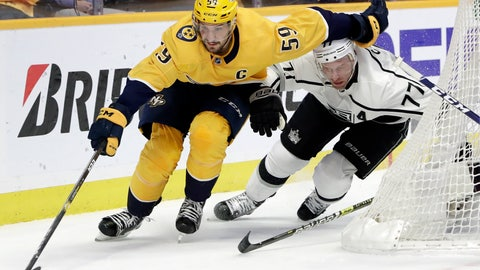 <p>               Nashville Predators defenseman Roman Josi (59), of Switzerland, moves the puck as Los Angeles Kings center Jeff Carter (77) follows during the first period of an NHL hockey game Thursday, Feb. 21, 2019, in Nashville, Tenn. (AP Photo/Mark Humphrey)             </p>