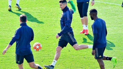 <p>               Juventus' Cristiano Ronaldo goes for the ball during Juventus' training session ahead of Wednesday's  Champions League soccer match against Atletico Madrid, in Turin, Tuesday, Feb. 19, 2019. (Alessandro Di Marco/ANSA via AP)             </p>