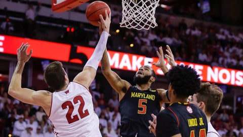 <p>               Wisconsin's Ethan Happ (22) blocks a shot by Maryland's Eric Ayala (5) during the first half of an NCAA college basketball game Friday, Feb. 1, 2019, in Madison, Wis. (AP Photo/Andy Manis)             </p>