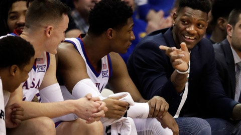 <p>               Kansas forward Silvio De Sousa, right, points to teammates during the second half of an NCAA college basketball game against Texas Tech in Lawrence, Kan., Saturday, Feb. 2, 2019. Kansas defeated Texas Tech 79-63. (AP Photo/Orlin Wagner)             </p>