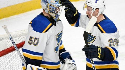 <p>               St. Louis Blues goaltender Jordan Binnington (50) and Vince Dunn (29) celebrate a win against the Minnesota Wild after an NHL hockey game Sunday, Feb. 17, 2019, in St. Paul, Minn. The Blues won 4-0. (AP Photo/Hannah Foslien)             </p>