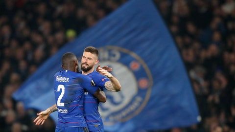 <p>               Fans display a large Chelsea flag as Chelsea's Antonio Rudiger, left, hugs Chelsea's Oliver Giroud who scored his side's first goal during the round of 32, second leg, Europa League soccer match between Chelsea and Malmo FF at Stamford Bridge stadium in London, Thursday Feb. 21, 2019. (AP Photo/Frank Augstein)             </p>