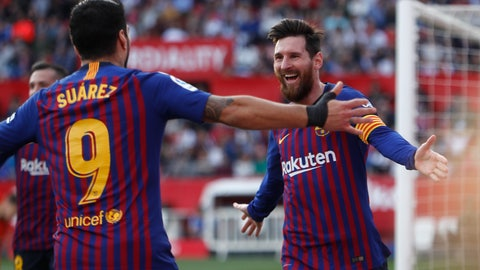 <p>               Barcelona forward Lionel Messi with his teammate Luis Suarez celebrate after scoring his side's third goal during La Liga soccer match between Sevilla and Barcelona at the Ramon Sanchez Pizjuan stadium in Seville, Spain. Saturday, February 23, 2019. (AP Photo/Miguel Morenatti)             </p>